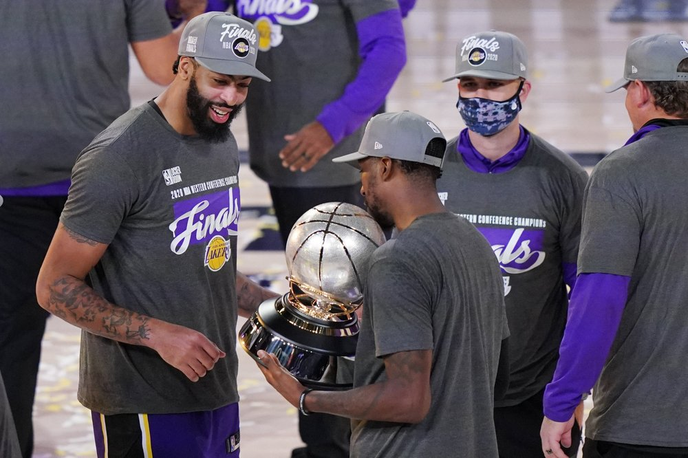 Los Angeles Lakers power forward Anthony Davis looks at their trophy after beating the Denver Nuggets during the 2020 Western Conference Finals