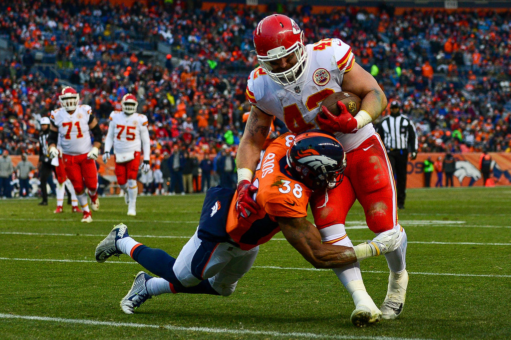 Kansas City Chiefs fullback Anthony Sherman is hit by Marcus Rios against the Denver Broncos