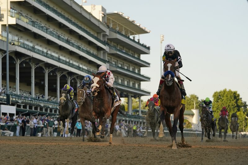 Authentic, ridden by jockey John Velazquez, crosses the finish line to win the 146th running of the Kentucky Derby
