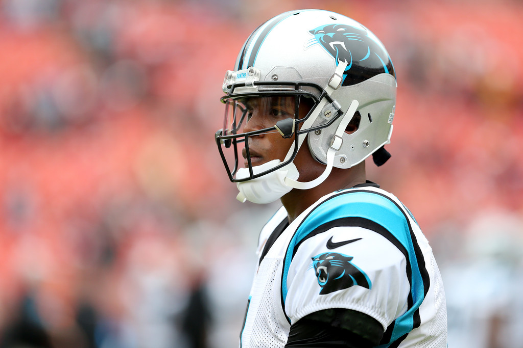 Former Carolina Panthers quarterback Cam Newton looks on prior to a game against the Washington Redskins