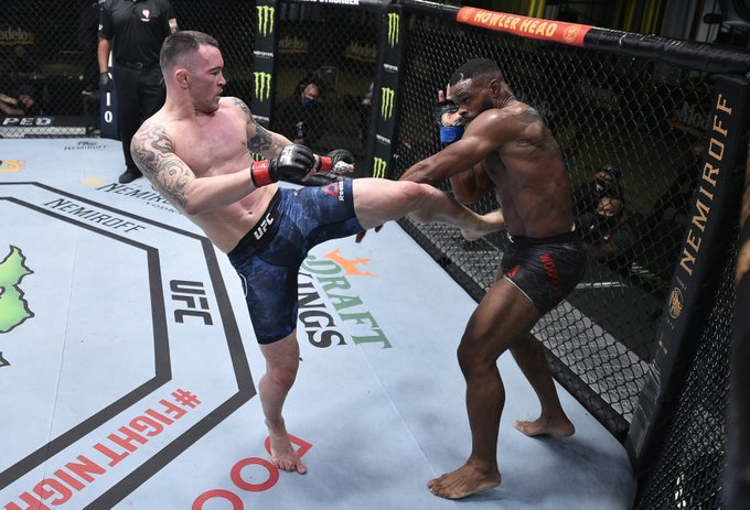 UFC fighter Colby Covington attempts to kick Tyrone Woodley in the main event of UFC Fight Night 178