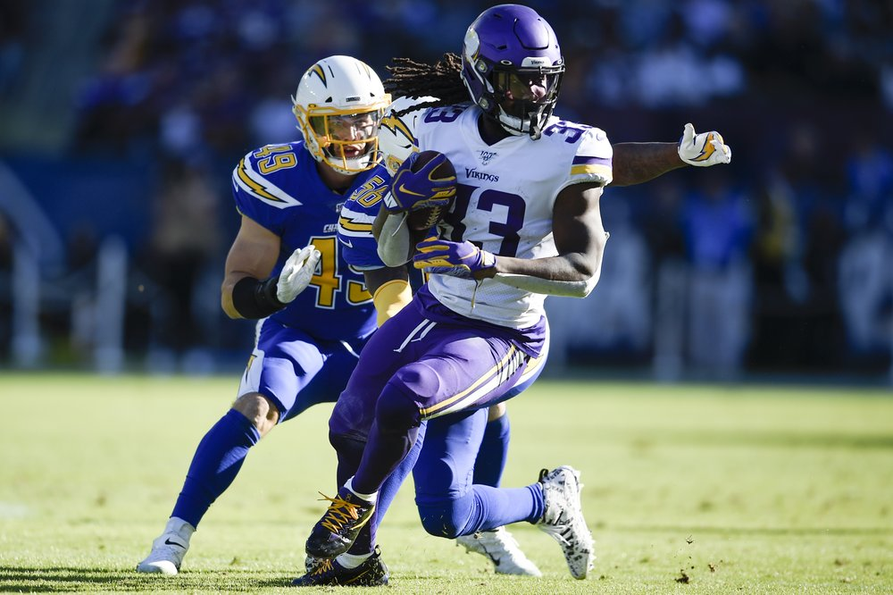 Minnesota Vikings running back Dalvin Cook runs with the ball against the Los Angeles Chargers