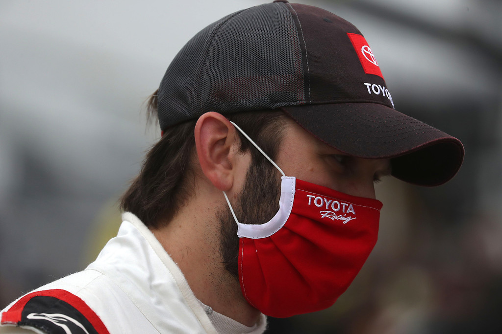 Toyota Certified Used Vehicles driver Daniel Suárez stands on the grid prior to the NASCAR Cup Series Big Machine Hand Sanitizer 400 Powered by Big Machine Records