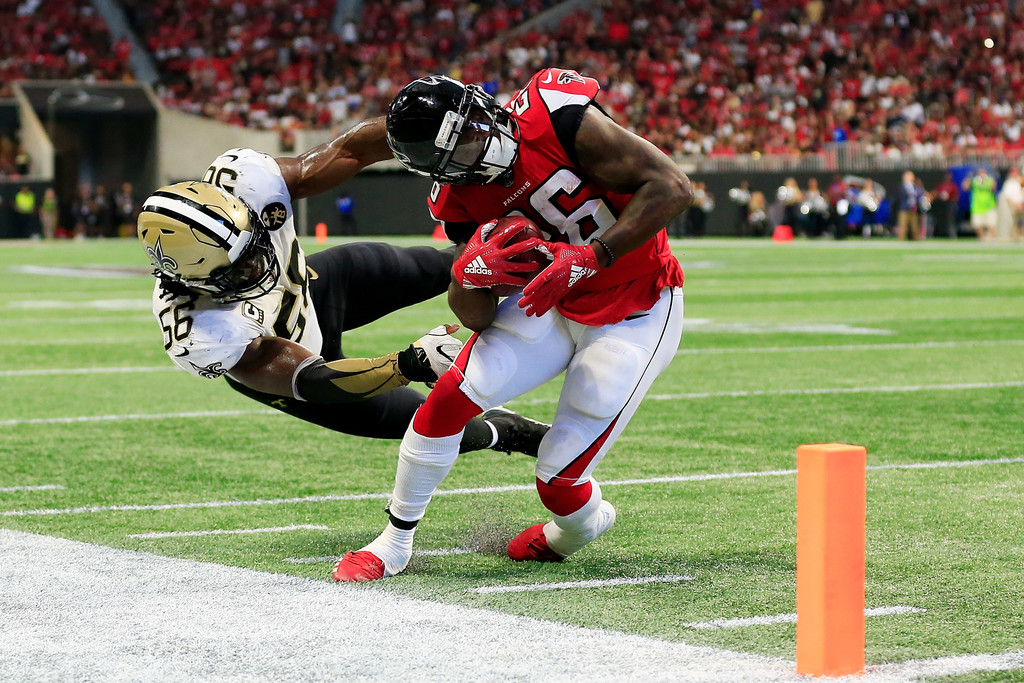 New Orleans Saints linebacker Demario Davis fails to tackle Tevin Coleman against the Atlanta Falcons, who scored a touchdown on the play