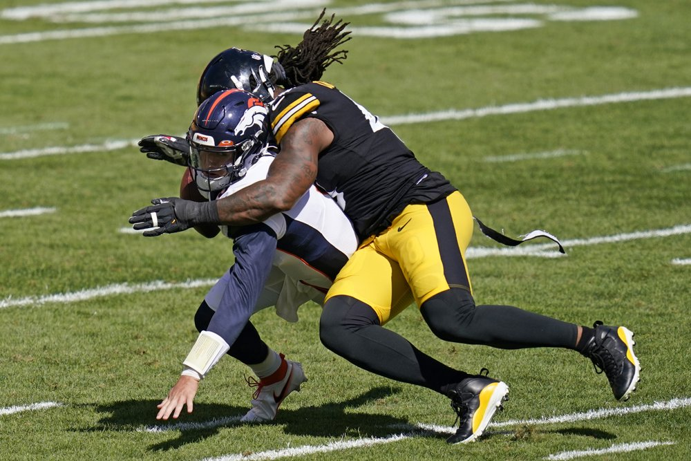Denver Broncos quarterback Drew Lock is forced to fumble the ball by Bud Dupree against the Pittsburgh Steelers