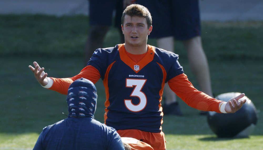 Denver Broncos quarterback Drew Lock takes part in drills during NFL football practice at the team's headquarters