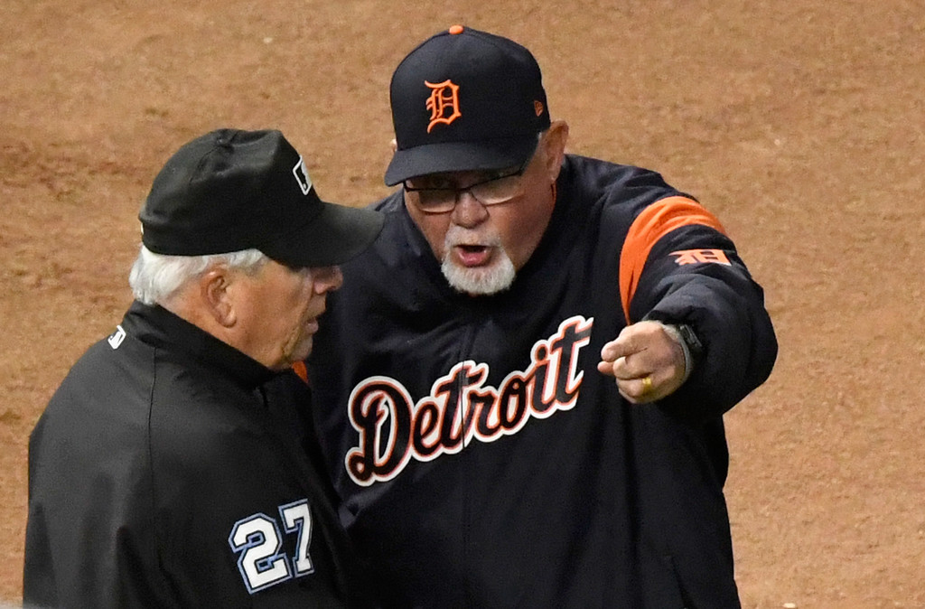 Former Detroit Tigers manager Ron Gardenhire speaks with umpire Larry Vanover after a replay overturned an out against the Minnesota Twins