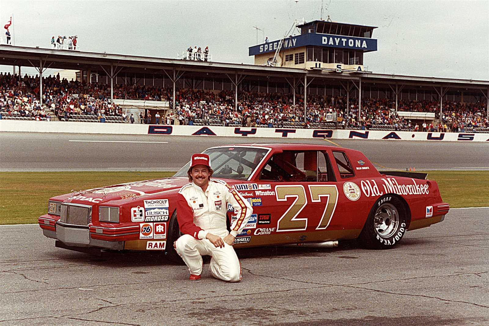 Former NASCAR driver Tim Richmond outside of his car at Daytona International Speedway