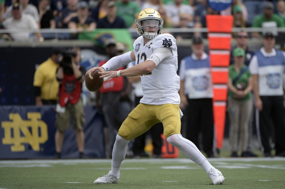 Notre Dame quarterback Ian Book throws a pass against the Iowa State Cyclones