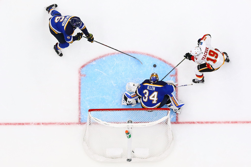 Former St. Louis Blues goaltender Jake Allen defends the goal from a shot by Matthew Tkachuk against the Calgary Flames