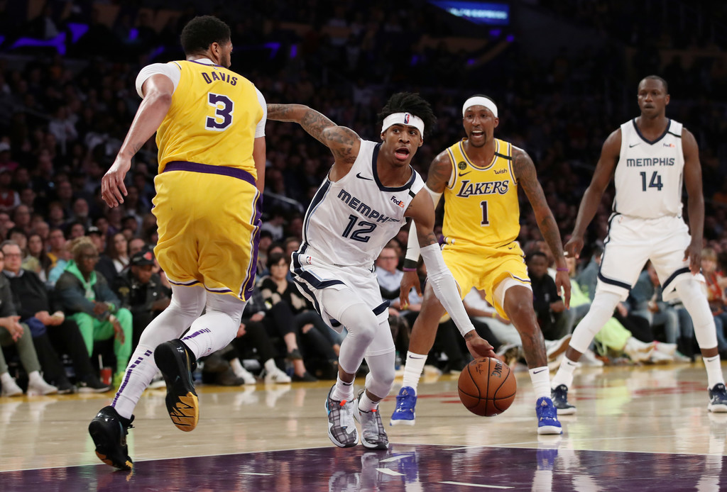 Memphis Grizzlies guard Ja Morant dribbles to the basket against the Los Angeles Lakes