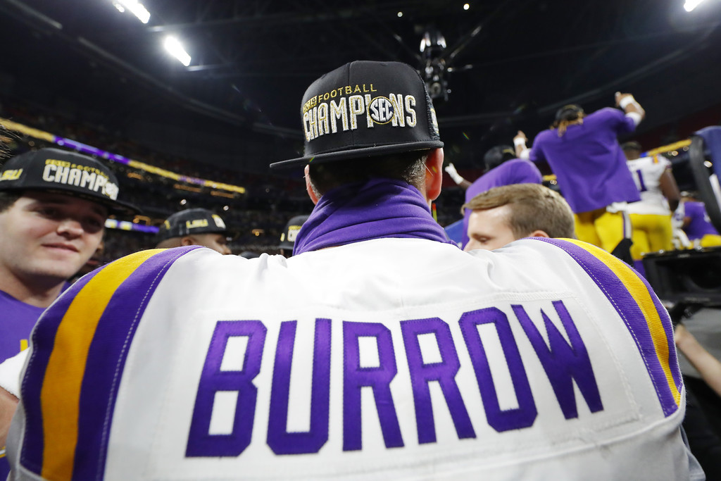 Former LSU Tigers quarterback Joe Burrow has his jersey detail photographed as he stool on the field following a win over the Georgia Bulldogs in the 2019 SEC Championship