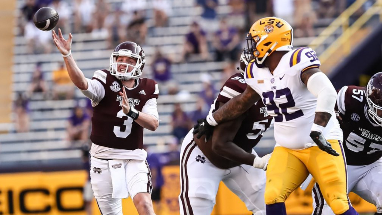 Mississippi State Bulldogs quarterback K.J. Costello attempting a pass against the LSU Tigers