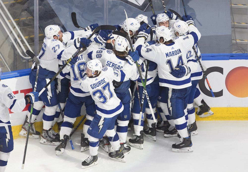 Tampa Bay Lightning players celebrate a win over the New York Islanders during overtime in Game 6 in the 2020 Eastern Conference Finals
