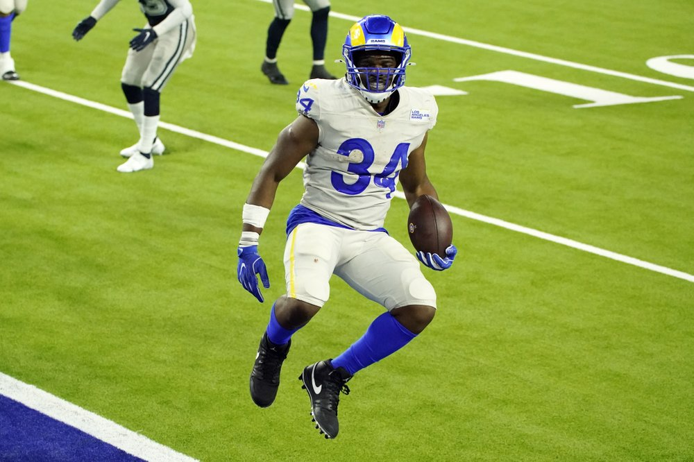 Los Angeles Rams running back Malcolm Brown leaps into the end zone for a touchdown against the Dallas Cowboys