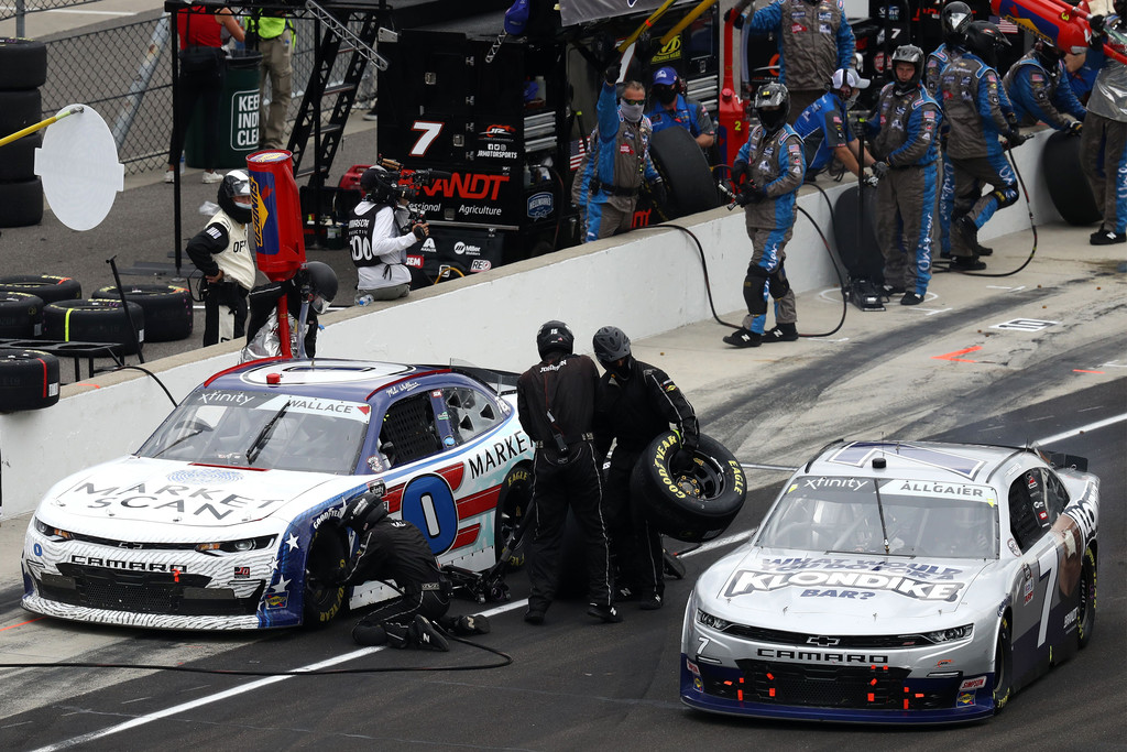 Market Scan Chevrolet driver Mike Wallace pits as Klondike Chevrolet driver Justin Aligaier exits pit road during the NASCAR Xfinity Series Pennzoil 150 at the Brickyard