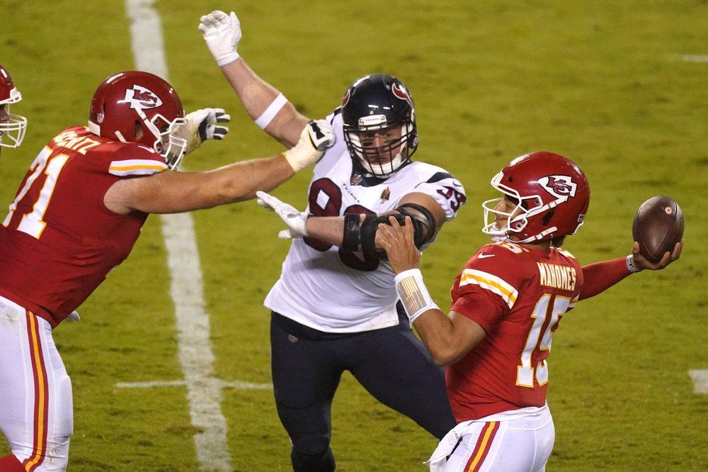 Kansas City Chiefs quarterback Patrick Mahomes attempts a passes as he is pressured by J.J. Watt against the Houston Texans
