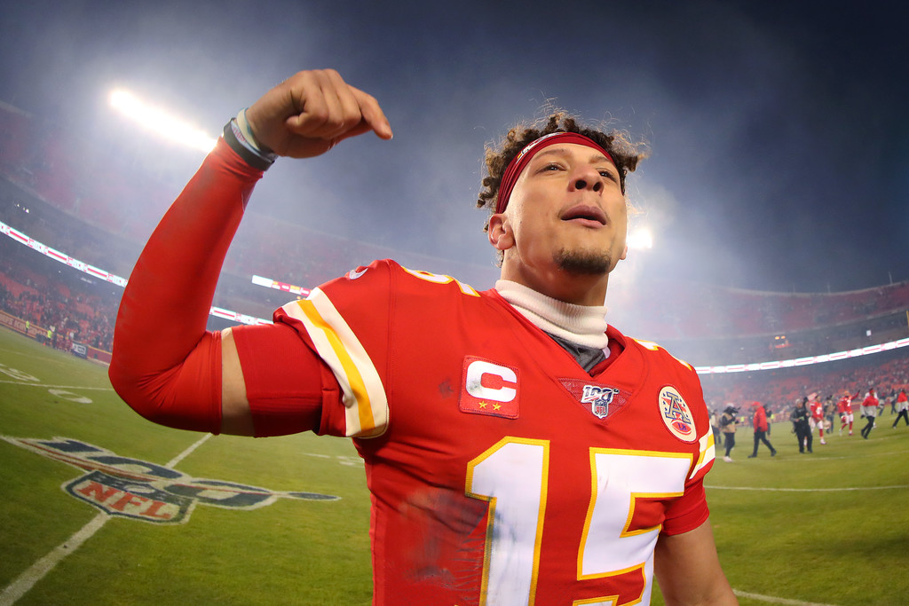 Kansas City Chiefs quarterback Patrick Mahomes celebrates with his teammates following the team's win against the Houston Texans in the AFC Divisional Playoff game