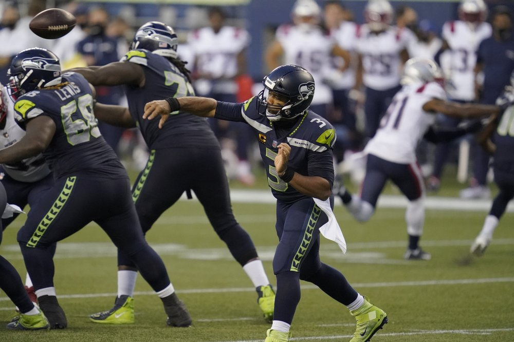 Seattle Seahawks quarterback Russell Wilson passes against the New England Patriots