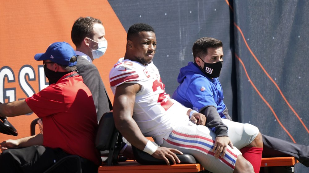 New York Giants running back Saquon Barkley is carted to the locker room after being injured against the Chicago Bears