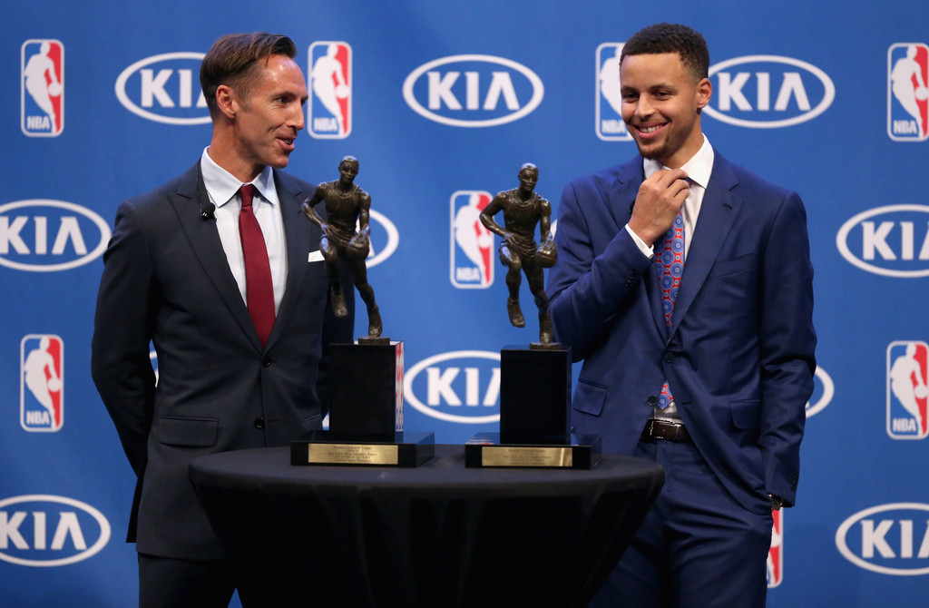 Former NBA player Steve Nash stands next to Stephen Curry when he won back-to-back NBA Most Valuable Player Awards