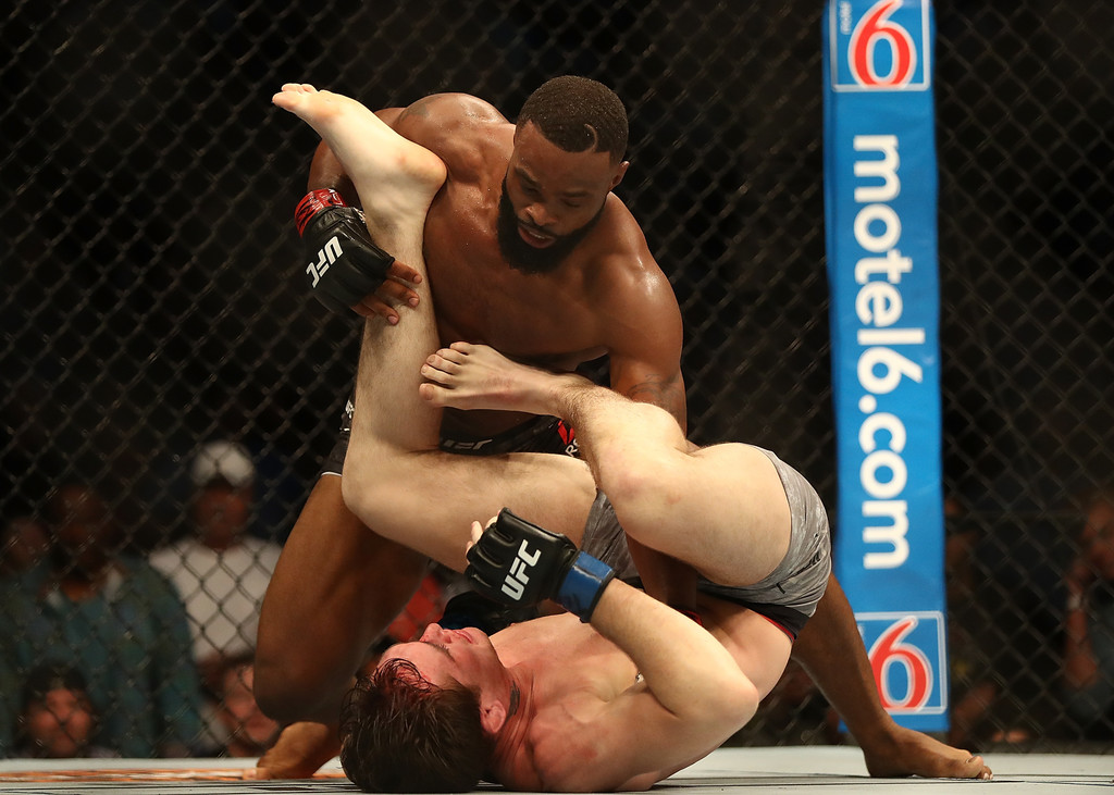 UFC fighter Tyron Woodley attempts to punch Darren Till in their UFC Welterweight Title bout during UFC 228