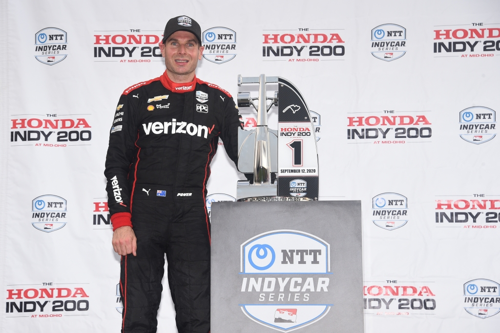 Verizon IndyCar driver Will Power stands with the Honda Indy 200 Race 1 trophy after winning the race