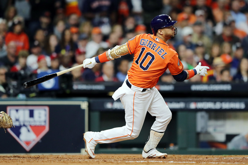Houston Astros infielder Yuli Gurriel hits a single against the Washington Nationals in Game Seven of the 2019 World Series