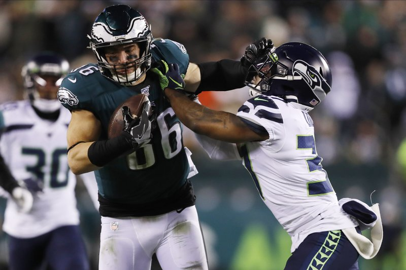 Philadelphia Eagles tight end Zach Ertz tries to hold off Seattle Seahawks safety Quandre Diggs during their 2019 NFL Wild Card Playoff game