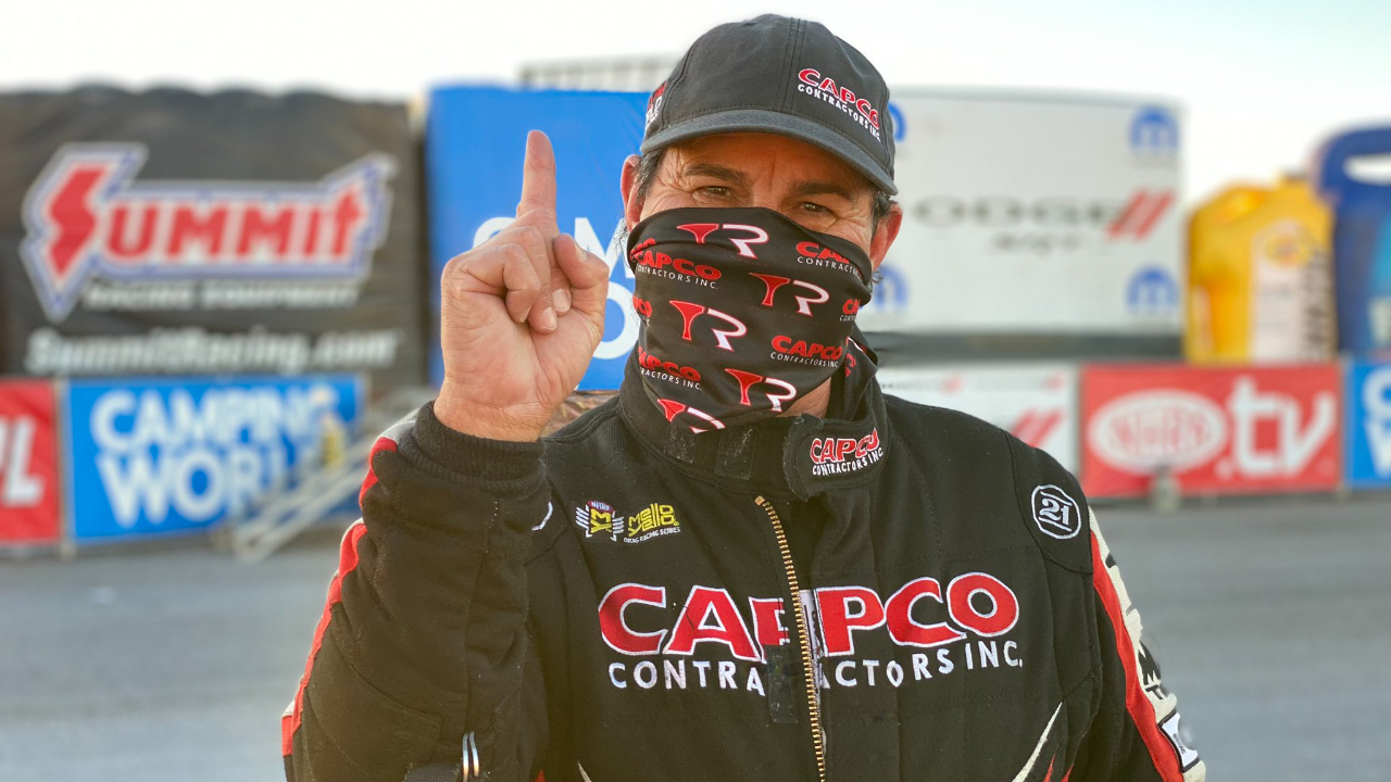 Capco Contractors Top Fuel Dragster Billy Torrence celebrates his No. 1 qualifier on Saturday at the 20th annual Dodge NHRA Finals presented by Pennzoil
