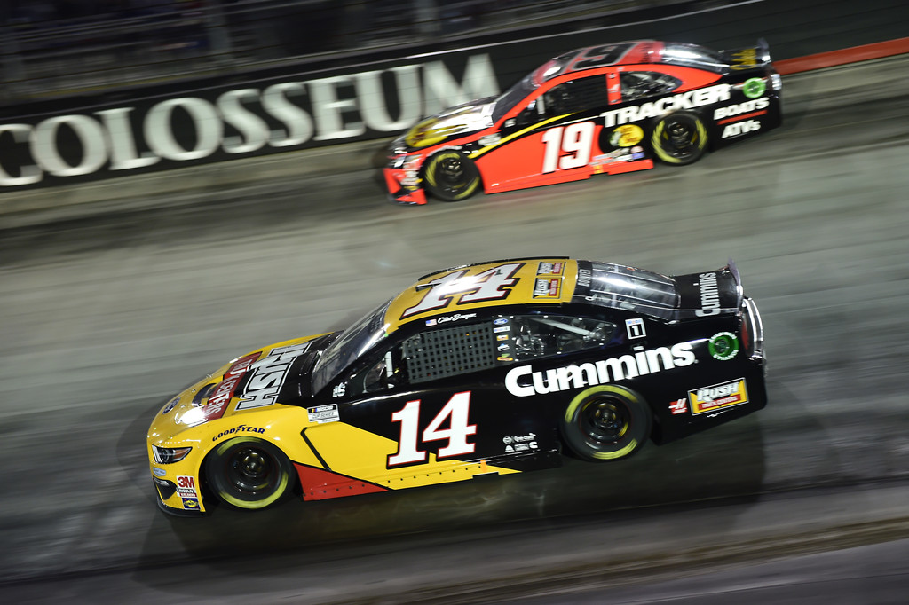 Rush Truck Centers/Cummins Ford driver Clint Bowyer and Bass Pro Shops Toyota driver Martin Truex Jr. race during the NASCAR Cup Series Bass Pro Shops Night Race