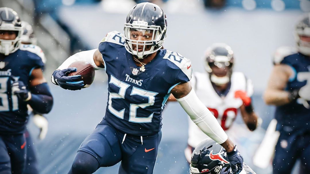 Tennessee Titans running back Derrick Henry carries the ball against the Houston Texans