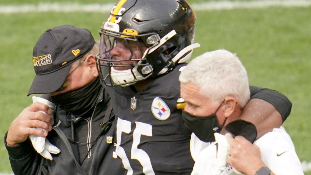 Pittsburgh Steelers inside linebacker Devin Bush Jr. is helped from the field after he was injured against the Cleveland Browns