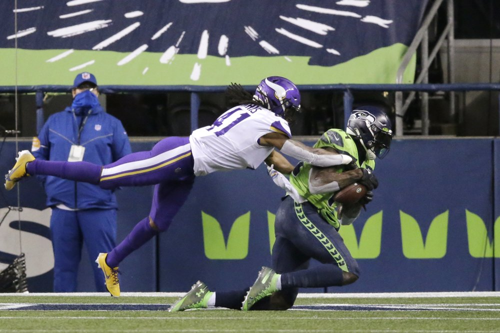 Seattle Seahawks wide receiver DK Metcalf catches a touchdown in the end zone against the Minnesota Vikings