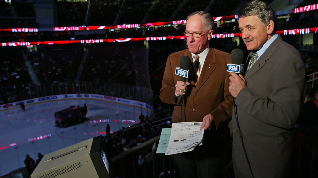 "Legendary Broadcaster Mike ""Doc"" Emerick and fellow broadcaster Glenn ""Chico"" Resch prepare for the NHL game between the Anaheim Ducks and the New Jersey Devils"