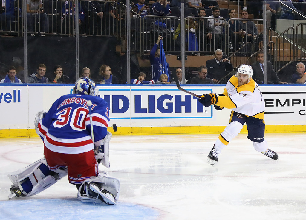 Former New York Rangers goalie Henrik Lundqvist makes a save from Mattias Ekholm against the Nashville Predators