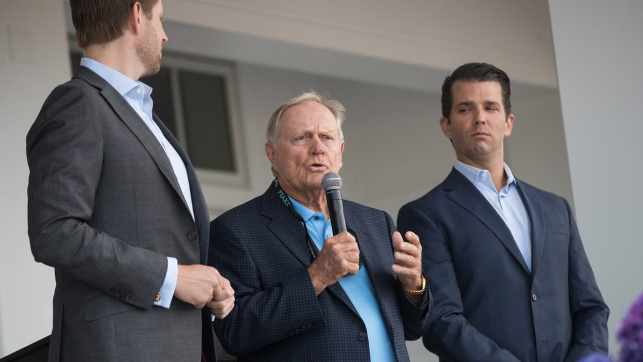 Golf legend Jack Nicklaus is flanked by Eric Trump and Donald Trump Jr. during a ribbon cutting event at a new clubhouse at the Trump Golf Links at Ferry Point