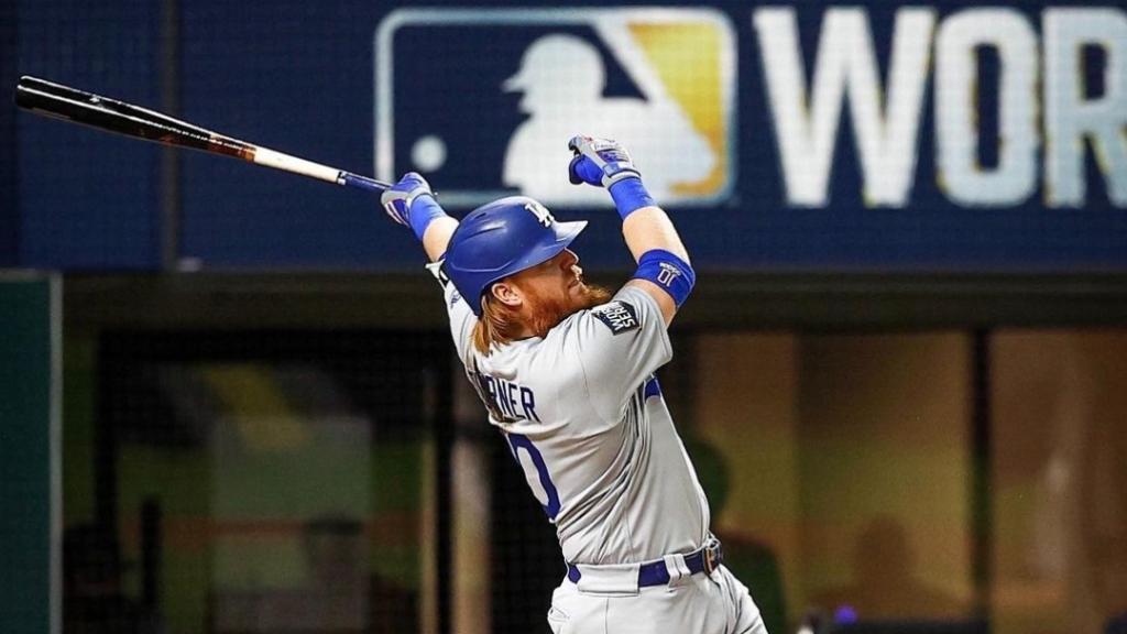 Los Angeles Dodgers third baseman Justin Turner hits a home run in Game 4 of the 2020 World Series against the Tampa Bay Rays in an 8-7 loss