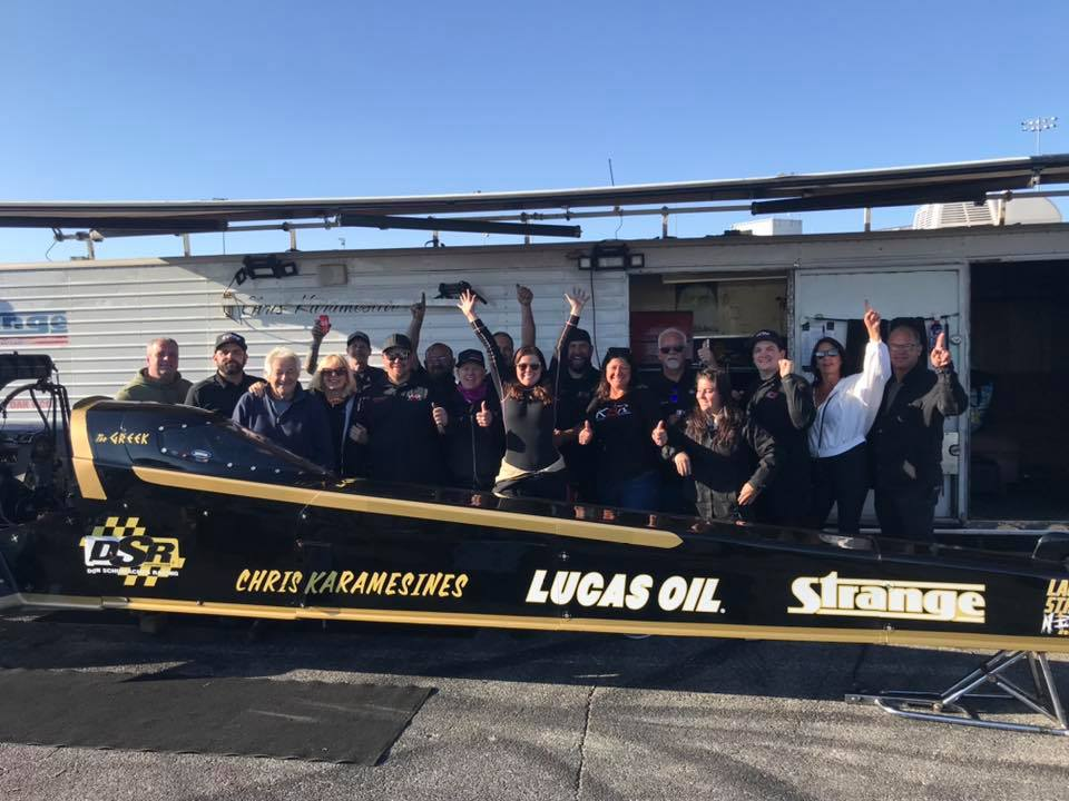 Top Alcohol Dragster pilot Krista Baldwin celebrates receiving her Top Fuel Dragster license