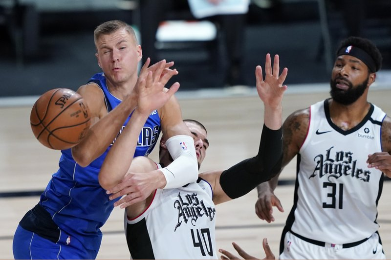 Dallas Mavericks power forward Kristaps Porziņģis battles Los Angeles Clippers center Ivica Zubac for the ball in the 2020 NBA Playoffs