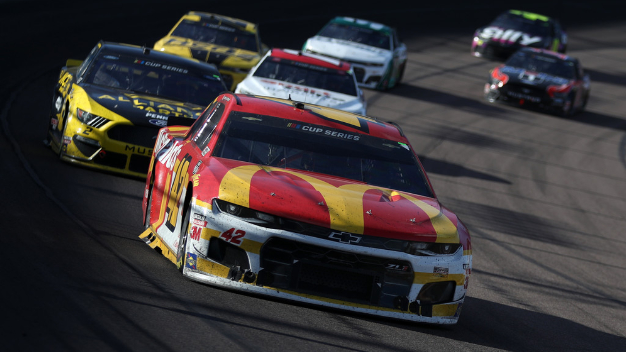 Former NASCAR driver Kyle Larson leads a pack of cars during the FanShield 500