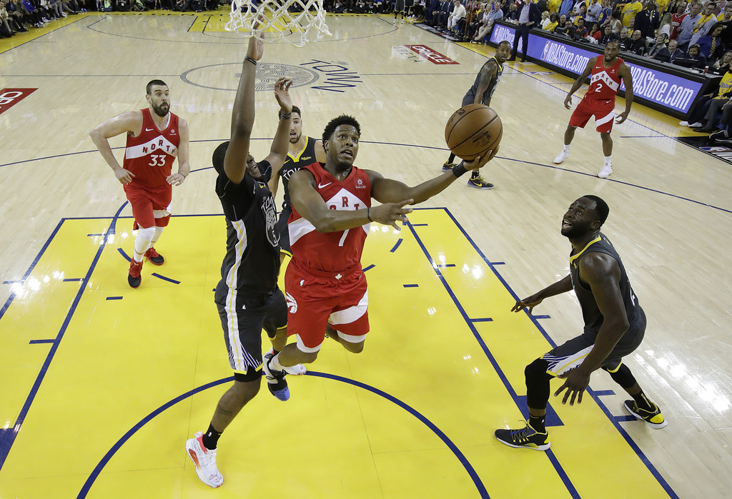 Toronto Raptors guard Kyle Lowry attempts a shot against the Golden State Warriors in Game Six of the 2019 NBA Finals