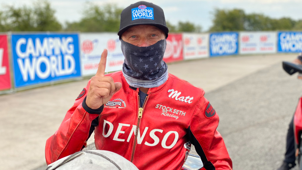 Denso Auto Parts Pro Stock Motorcycle rider Matt Smith celebrates after getting the No. 1 qualifier at the AAA Texas NHRA FallNationals