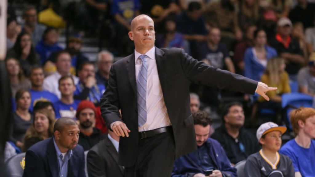 Basketball Coach Nate Bjorkgren coaching during a game