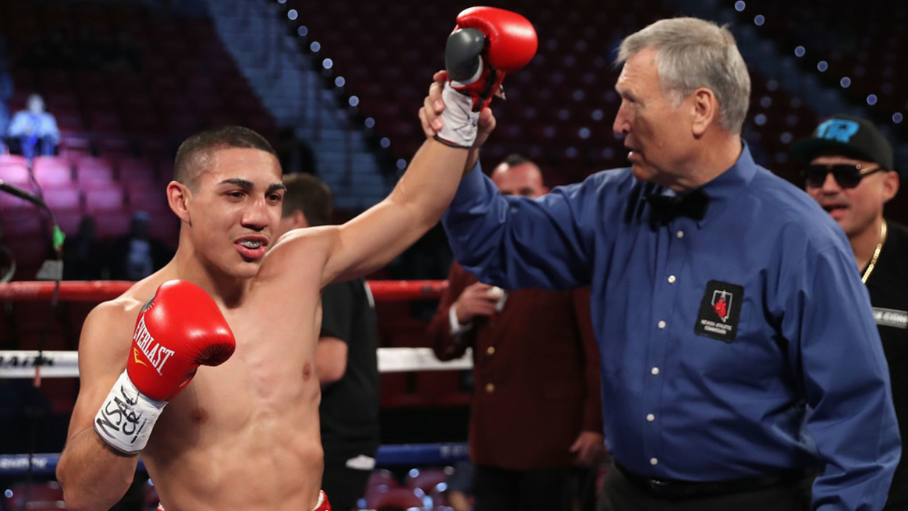 Teófimo López Jr. celebrates his knockout victory over Ishwar Siqueiros during their lightweight fight