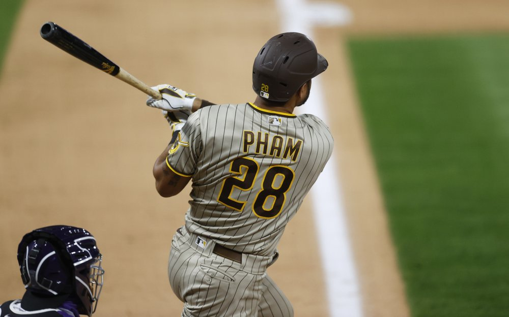 San Diego Padres outfielder Tommy Pham follows the flight of his three-run home run off Colorado Rockies relief pitcher Wade Davis in the ninth inning