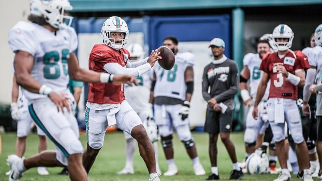 Miami Dolphins quarterback Tua Tagovailoa attempts a pass during practice