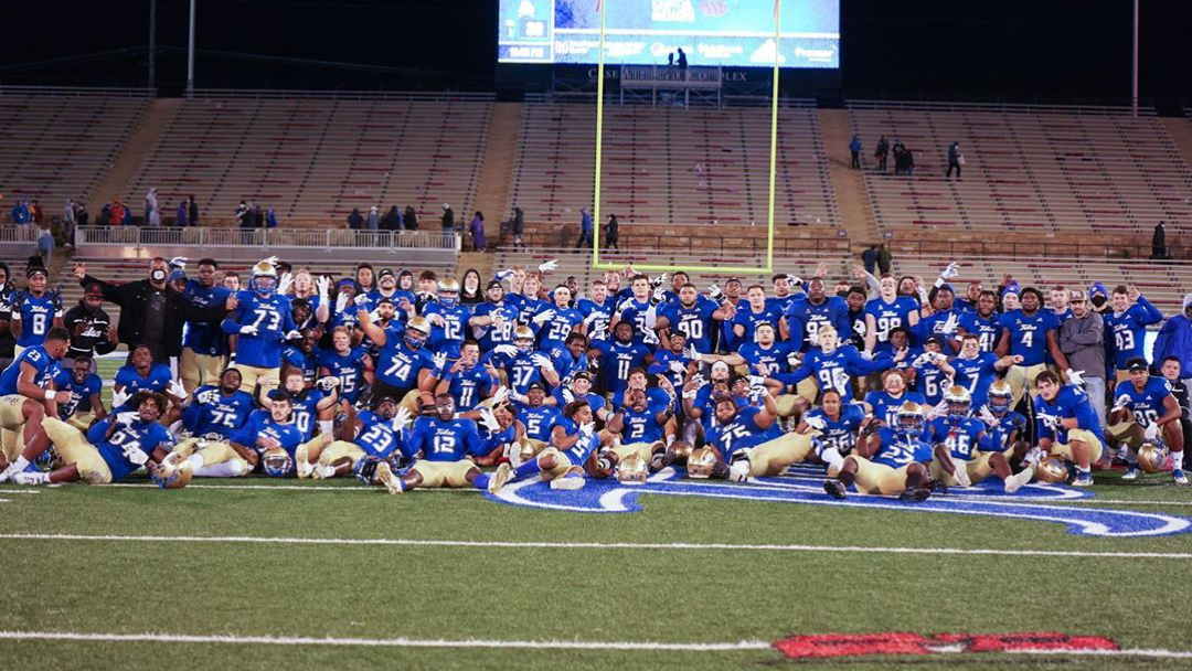Tulsa Golden Hurricane celebrates their 34-30 win over the East Carolina Pirates with a group photo