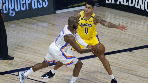 Oklahoma City Thunder guard Chris Oaul is defended by Kyle Kuzma against the Los Angeles Lakers