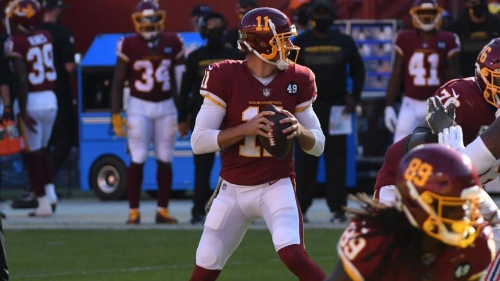 Washington Football Team quarterback Alex Smith attempts to throw a pass against the New York Giants